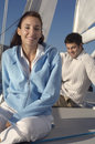 Middle Aged Woman On Sailboat Stock Image