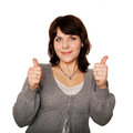 Middle aged woman showing thumbs up sign isolated white background Royalty Free Stock Photo