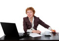 Middle-aged woman at the table, a laptop Royalty Free Stock Photography