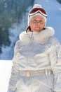 Middle-aged woman in a white jacket  ski  glasses Royalty Free Stock Photos