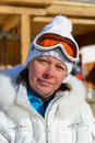 Middle-aged woman in a white jacket and ski goggles Stock Images