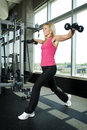 Middle aged woman working out with weights Stock Image