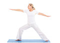 Middle aged woman yoga healthy practicing exercise on white background Royalty Free Stock Images
