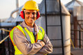 Middle aged worker happy oil chemical industry inside plant Royalty Free Stock Image