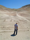 In the middle of desert man surrounding by sand Royalty Free Stock Images