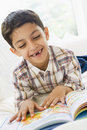 Middle Eastern boy reading Royalty Free Stock Image