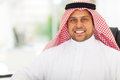 Middle eastern businessman close up portrait of happy in office Stock Photo