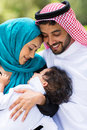Middle eastern couple and baby boy happy outdoors Stock Photo