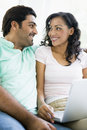 Middle Eastern couple sitting with a laptop Royalty Free Stock Photography