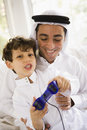 A Middle Eastern father and son playing Royalty Free Stock Photo