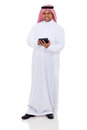 Middle eastern man tablet full length portrait of using computer on white background Royalty Free Stock Image