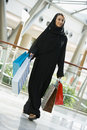 A Middle Eastern woman in a shopping mall Royalty Free Stock Photography
