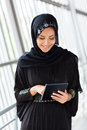 Middle eastern woman tablet happy using computer Stock Images