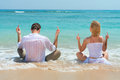 Middle finger gesture by happy young couple showing and enjoying at beach with blue sea on background Royalty Free Stock Photo