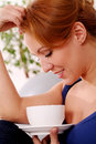 Middleaged happy woman enjoy her morning cup tea home Stock Images