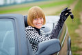 Middleaged woman with her new car trendy Stock Photography