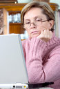 Middleaged woman using laptop Royalty Free Stock Photo