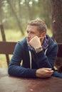 Midlife crisis man thinking portrait sitting outside Royalty Free Stock Photo