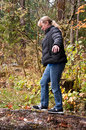 Midlife Woman Walking on Log in Forest Royalty Free Stock Photo