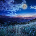 Midnight moon in highland full sky over the top of a high mountain Royalty Free Stock Images