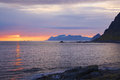 Midnight sun in norway scenic over the ocean on lofoten islands during polar day Stock Photos