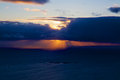 Midnight sun scenic rays behind clouds during night in the arctic norway Royalty Free Stock Photography