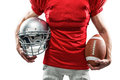 Midsection of American football player holding helmet and ball Royalty Free Stock Photo