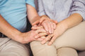Midsection of couple holding hands while comferting eachother Royalty Free Stock Photo