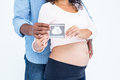Midsection of couple holding sonogram Royalty Free Stock Photo