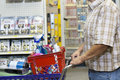 Midsection of man with shopping cart in hardware store Royalty Free Stock Photography