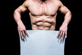 Midsection of muscular man holding white blank paper Royalty Free Stock Photo