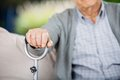 Midsection of senior man holding metal walking stick at nursing home Royalty Free Stock Photography