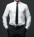 Midsection of young businessman in formal white shirt, black tie Royalty Free Stock Photo
