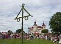 Midsummer celebrations in sweden front of lacko castle at lake vanern Royalty Free Stock Images