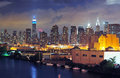 Midtown manhattan beyond the queens shore new york city at dusk with skyline visible Royalty Free Stock Images