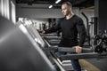 Mighty man on treadmill Royalty Free Stock Photo