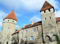 Mighty old town wall with impressive defensive towers walls standing in the heart of tallinn city centre Stock Images