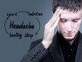 Migraine concept prevention of headache the man in the gray suit headache Royalty Free Stock Photography