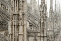 Milan cathedral roof gothic ornaments spire pointed archs statues Royalty Free Stock Photo