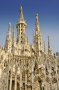 Milan Cathedral roof and Madonnina Stock Photos