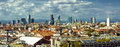 Milan cityscape panorama view of city in italy taken from rooftop of duomo cathedral modern city buildings and alps mountains in Stock Photos