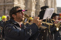 Milan italy february bugle player band parade background blurred minster shot kid s carnival parade minster square feb milan italy Stock Image