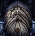 Statue of crucified Jesus Christ inside Milan Cathedral. Holy cross in interior of dark Catholic church, view of crucifix over Royalty Free Stock Photo