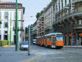 Milan street with orange tram Royalty Free Stock Photography