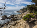 Mile drive is a scenic road through pebble beach and pacific grove on the monterey peninsula in california much of which hugs the Royalty Free Stock Photo
