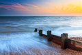 Milford on sea hampshire groynes at sunset in england uk europe Royalty Free Stock Photos