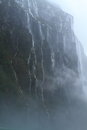 Milford sound hundreds of waterfalls flowing from the mountains during the rainstorm in fiordland national park new zealand Royalty Free Stock Photo