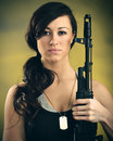 Militarized young woman with assault rifle a caucasian an Royalty Free Stock Photo