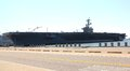 Military aircraft carrier pier side norfolk virginia u s navy in the naval station harbor Stock Photo