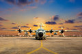 Military aircraft on the runway during sunset. Royalty Free Stock Photo